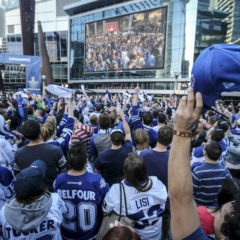 Maple Leaf fans cheer for themselves as they come up on the big screen in Maple Leaf Square