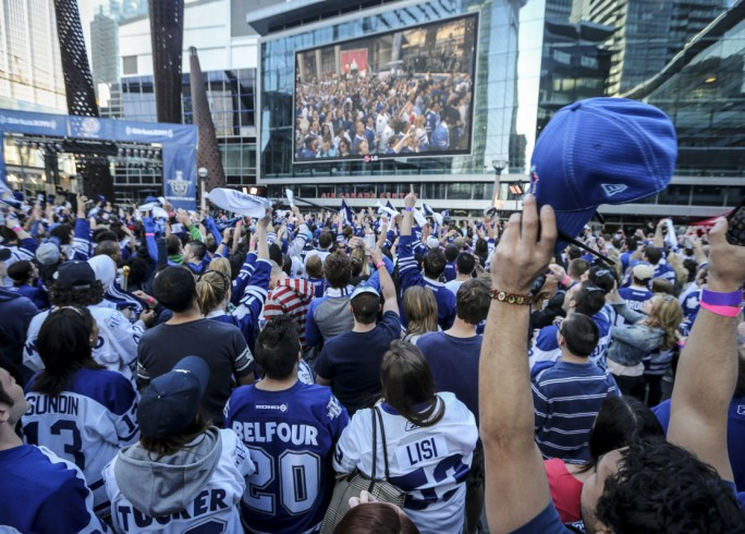 SP-ACC1MAY TORONTO  ON - Maple Leaf fans cheer for themselves as they come up on the big screen in Maple Leaf Square  during game one of the Leafs Bruins series outside the Air Canada Centre May 1, 2013. David Cooper/Toronto Star